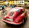 Classic Porsche in Grebe, Italy (Randy Durrum) Tags: classicporscheingrebe italy cobblestones bike bicycle red piazza durrum canon eos m eosm grebe