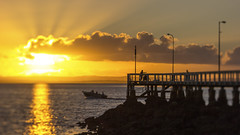Glorious (jsnowy2768) Tags: wellingtonpoint goldenhour queensland moretonbay water bay reflections sunrise fishermen fishing boat clouds jetty rocks waves park redlands sun lensbaby edge80 selectivefocus