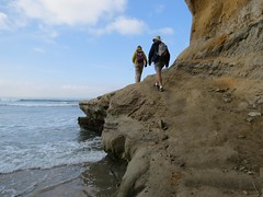 Going over the rock because the water was too high to go around on the sand (aking1) Tags: sandiego california unitedstates