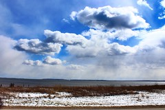 Snow and Clouds (paleyphotos) Tags: clouds blue snow beach new york contrast light sun nyc staten island atmoshperic landscape scenic scenery