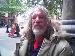 Needs a Beer (abbyladybug) Tags: cameraphone seattle homeless bum thursday panhandler pioneersquare