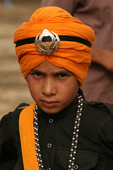 Gatka Team Member for the Camera, Amritsar (INDIA) (Captain Suresh Sharma) Tags: travel portrait india holiday heritage religious soldier healthy asia fighter colours symbol religion young culture crest health looks warrior sikh punjab defence punjabi saffron defend headgear theface gatka devoution photokranti
