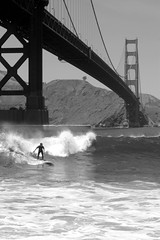 Catch Or Be Crushed (cwgoodroe) Tags: sf sanfrancisco bridge bw water golden gate surf surfer landmark surfing shore goldengate longboard unusual sfchronicle 96hrs sfchronicle96hours sfchronicle96hrs