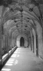 Lacock Abbey Cloisters (richardr) Tags: door old uk greatbritain shadow england blackandwhite bw building english heritage history monochrome abbey architecture dark geotagged blackwhite europe european unitedkingdom britain gothic arcade arches historic british vault cloister wiltshire foxtalbot nationaltrust cloisters europeanunion lacock gothicarchitecture lacockabbey vaulting historicalplaces lacockcloisters geo:lat=51415535 geo:lon=2121735