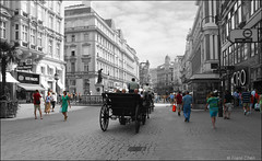 A Moment In Life (fcphoto) Tags: vienna wien street old city travel shadow urban bw horse cloud sun white black building sterreich shop architecture clouds standing photoshop buildings shopping walking wagon landscape austria stand blackwhite bravo europe artistic outdoor near walk photoshopped fineart wide perspective grand tourist tourists stadt shops far passerby colorkey leisurely interestingness499 i500 250v10f fcphoto explore11jul06 wideangleminolta