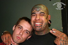 Ugly and Edwin (DawnOne) Tags: shadow ontario canada green tattoo bar hair dawn hotel photos head  large piercing linda ugly mohawk 2009 hammond spikes edwin skinhead guage diplomat tattoed indyfotocom guelf