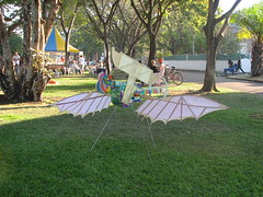 flying (GeoWombats) Tags: sculpture art guitar nt australia august darwin 2006 contraption winged pc0800 civicpark sculptureinthepark darwinfringefestival geowombats