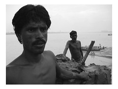clay trader | Kolkata (arnabchat) Tags: portrait india water monochrome composition river boat double clay worker porter favs kolkata bengal calcutta hooghly ghaat supershot kumartuli arnabchat arnabchatterjee