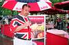SteaksInLondon (ponyintheair) Tags: uk england usa london rain umbrella august tourist contax leicestersquare t3 unionjack fujisuperia200 streetsmilecontest2 steaksinlondon ukandusa
