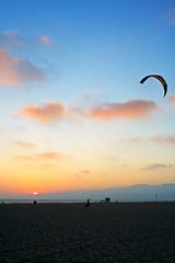 Parasunset ('SeraphimC) Tags: ocean california pink blue venice sunset people orange kite beach delete10 clouds canon delete9 delete5 350d delete2 pacific delete6 delete7 peach delete8 delete3 delete delete4 save save2 100mm parasail rebelxt