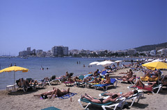 F-0101.jpg (Alex Segre) Tags: sea summer vacation people holiday hot beach sanantonio islands seaside spain mediterranean chairs tourists deck ibiza leisure recreation sunbathing crowded balearic balearics alexsegre