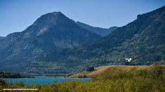 Prince of Wales Hotel (Witty nickname) Tags: trees summer lake mountains green water landscape hotel landscapes alberta rockymountains waterton d800 70200mm princeofwaleshotel watertonlake southernalberta nikond800 70200mmvrii nikkor70200mmf28vrii