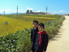 Two north Korean boys next to Rice Paddy and soybean field (FAO of the UN) Tags: asia korea unitednations northkorea dpr democraticpeoplesrepublicofkorea faooftheun unfao jointfaowfpassessmentmission