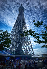 Tokyo Sky Tree in Japan (` Toshio ') Tags: people japan architecture clouds restaurant tokyo crowd tourists nippon nihon broadcasttower toshio skytree xe2 tokyoskytree fujixe2