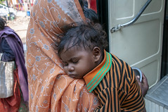 INDIA7366 (Glenn Losack, M.D.) Tags: street people india portraits photography locals child delhi muslim islam poor mother photojournalism buddhism impoverished flip flops local hindu scenics handicapped deformed beggars streetphotographer glennlosack losack glosack dahlits