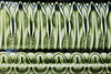 Tile with trees (Djaron van Beek) Tags: abstract pattern monochrome tile outerwall antique oneseparatetile artdeco nottreesbutcabbageparts artistunknown curves lines geometry elegant design forms repetition organic amsterdam architectural ornament closeup minimal graceful green textures veins stylized detail sheen glazed enamel composition symmetry bokeh dof depthoffield myinterpretation probablymadearound1910 treasurefromthepast smallcracks beautyofdecay notthatmuchprocessed lightandshadowsmakethislooklike3d djaron djaronvanbeek