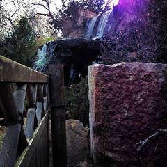 sasebo fence and waterfall (johngpt) Tags: lowylensblankofilmjollyrainbo2xflash sasebojapanesegarden water waterfall fence appleiphone5 abqbotanicgardens places hipstamatic albuquerque newmexico unitedstates us
