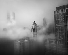 Foggy Chicago Skyline (mckenziemedia) Tags: chicago illinois michiganavenue window windows buildings skyline architecture blackandwhite monochrome fog foggy lowkey skyscraper sky clouds light dark iphone shotoniphone iphoneography
