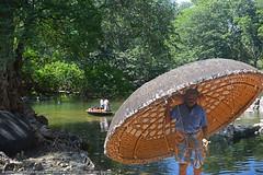 MAN IN A SHELL (GOPAN G. NAIR [ GOPS Photography ]) Tags: gopsorg gopangnair gops gopsphotography gopan photography caracle boat boatman hoganikkal water falls kaveri river hogenakkal tamilnadu karnataka tour
