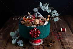 Horizontal View of Christmas Tin filled with Nuts and Spices on Rustic Table (Misc) (hypesol) Tags: black brown celebration centrepiece christmas color contrast crafts creative creativity dark decor decoration decorative detail eucalyptus festive foliage food gift handmade healthy hobby holidays homemade horizontal merry natural nature nuts present raw red ribbon rustic seasonal shadows snack tablesetting texture thrifty vintage walnuts warm wholesome winter wood wooden xmas