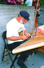 img407 Man with a blue cap and beard playing a string musical instrument - Looks like a koto or Guzheng (zither) (kalihikahuna74 (OkinawaKhan808)) Tags: unitedstates us stateside san francisco sanfrancisco california america thebay bayarea fixed trip vacation august 1997 1990s 90s analog predigital camera scan scaned old school oldschool pointandshoot pointandshootcamera unitedstatesofamerica