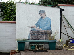 Fixing the net (Beth M527) Tags: streetart scotland angus murals arbroath 2015