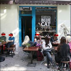 homemade baked goods (PIKTORIO) Tags: street blue people berlin kreuzberg germany outside cafe sitting boom sidewalk american bluecat gastronomy inkognito piktorio redbarface