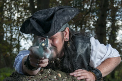 Har Har Me Hearties Bullseye (Nikon Nutter 2009) Tags: trees leaves log shot pirate pistol earrings taking whiteshirt piratehat leatherwaistcoat