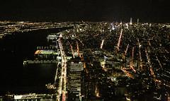 Looking Up The Hudson River (wyojones) Tags: new newyork newyorkcity manhattan lowermanhattan oneworldtradecenter observationdeck top view hudsonriver buildings roads streets lights night piers river water newjersey