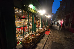 """scurry past or shop? Christmas is coming to Honfleur, Normandy, France (grumpybaldprof) Tags: honfleur normandy normandie france night dark gloaming visitors tourisme cold shop regionalproductsshop regional products shopping december nightfall christmasshopping building details colours contrast architectural textures bricks age features wandering streets doors collombage wood timber slate """"halftimbered"""" oak plaster traditional norman bottles baskets cider calvados applebrandy sigma 1020 1020mm f456 """"sigma1020mmf456dchsm"""" gribouille httpswwwflickrcomphotos107947995n0631691416111indatepostedpublic """"ruedel'hommedebois"""""""