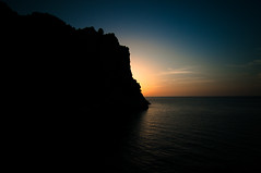 Sunset silhouette (m0nt2) Tags: sunset silhouette sea orange blue mallorca rock evening bay wrinkles water