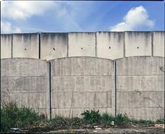 Walls always fall in the end. (wojszyca) Tags: mamiya rz67 6x7 120 mediumformat 75mm shift kodak ektachrome e100g gossen lunaprosbc epson v800 wall concrete pattern sky texture