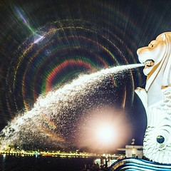 Merlion Flares (jaredlucow) Tags: sony a7s merlion 50mm night singapore mitakon flare