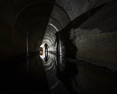Facing Demons (Robert Hannah) Tags: urban urbanexploring urbex culvert underground tunnel dark light demon lightpainting supernatural eerie explore exposure longexposure