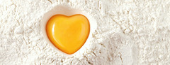 love to bake it!  egg  yolk on flour, full frame (portfolionewyork) Tags: white kitchen yellow closeup bread recipe baking raw heart dough egg homemade bakery ingredients pastry studioshot organic flour shape bake heap preperation cracked preparation freshness preparing yolk unitedkingdomofgreatbritainandnorthernireland