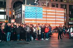 The Watching Mass (Rob Mintzes) Tags: nyc newyorkcity portrait people urban ny newyork public america person unitedstates flag timessquare times
