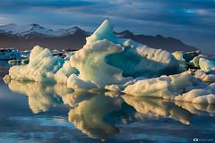 Iceberg (Fabio tomat) Tags: sunset sun snow mountains ice water birds iceland nikon tramonto lagoon acqua icebergs jkulsrln ghiaccio ghiacciaio islanda icerocks fabiotomat