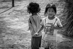 The Look (Mild Delirium) Tags: winter people blackandwhite bw children cambodia southeastasia khmer kh 1855mm biketouring kampuchea kandal  fujifilmxe1 xf1855mm fujinonxf1855mmf284 leukdaek