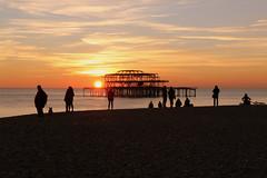 West Pier Sunset (Crisp-13) Tags: west pier brighton sussex sunset red sky beach sun people silhouette pebble