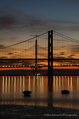 Down At The Pier (ajp~) Tags: southqueensferry hawespier forthroadbridge queensferrycrossing firthofforth scotland bridge bridges lights reflections sea water landscape longexposure sky clouds sunset evening pier crane construction canon 6d canon24105mmf4l alanjohnstone