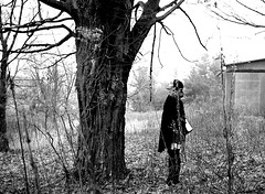 Alone and abandoned (amablecruz1) Tags: landscape nature old woods country leaves sticks tree loneliness woman bw blackandwhite
