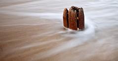 Sea Snake (kellystark92) Tags: sand sea beach coast coastal shapes texture northeastcoast northumberlandcoast seatonsluice stump wooden slowshutterspeed seaside beachphotography