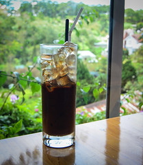 Black coffee with ice - Vietnamese style (phuong.sg@gmail.com) Tags: asia asian background beverage black brew brewed brewing cafe centralhighlands coaster coffee coffeefilter condensed cubes cup dalat drink drip espresso filter glass gourmet hot ice iced milk mocha mountain pot reflection refreshment restaurant small spoon style traditional vietnam vietnamese vietnameseicedcoffee