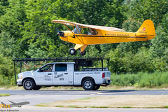 Piper Cub Landing on Truck (rmssch89) Tags: lake demo cub newjersey display greenwood airshow piper aerobatics westmilford alabamaboys
