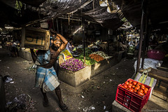 Hardship (anandgovindan) Tags: life lighting street morning travel light shadow portrait people sunlight india color colour vegetables muscles work canon colorful day colours lift market spirit ngc feel madras wideangle vegetable tokina adobe shade sweat strong effort strength load chennai hardwork carry journalism tamilnadu slog southindia determination lightroom twop cwc hardship workship saidapet 1116mm nammachennai tokina1116mm saidapetmarket canon600d chennaiweekendclickers mychennai anandgoviphotography anandgovindan cwc479