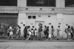 Keep walking... (anthonyleungkc) Tags: people bw walking lumix hongkong blackwhite outdoor candid olympus snap panasonic asph f28 omd lightroom vario m43 mft em5 1235mm microfourthirds x1235