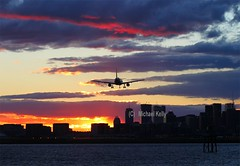Dusk arrival (Flame1958) Tags: travel sunset vacation holiday flying holidays dusk aviation flight loganairport bostonloganairport enroute 1015 2015 sunsetflight bostonlogan duskarrival 171015 bostondusk duskflight airportdusk arrivaldusk