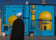 mullah passing in front of a painting depicting a mosque, Central County, Qom, Iran (Eric Lafforgue) Tags: blue people man male men yellow horizontal beard outdoors person clothing paint adult iran propaganda painted muslim islam traditional religion middleeast age shia daytime local iranian turban rearview bearded hussein oneperson mullah islamic iman headgear shiite hussain qom middleagedman ghom persiangulfstates 40sadult  onemanonly  16499 unrecognisableperson husayn colourimage 1people  iro  unrecognizableperson centralcounty westernasia  qomprovince