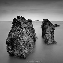 in between.. (sirman88) Tags: white azmanrahman f8 unknown stone guardian pasie panjang water kelong gone collapsed bw blackwhite simplicity fbe structure sky shelter leading dark alone black sea dry dying incompatible glorious interestingness light malaysia motion panorama pointing revisited sirman sirman88 traveldestinations photographyoutdoors