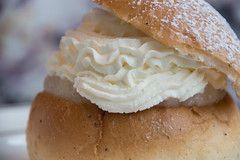 Semla (lent bun) - whipping cream and almond paste in between (Maria Eklind) Tags: fattuesday fettisdagen semla whippingcream spaceintbetween pastry emellan mandelmassa inbetween closeup almondpaste macromondays cream between lentbun malmö skånelän sverige se